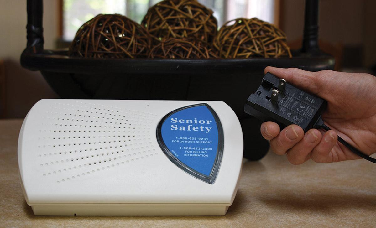 senior safety monitor with hand holding plug